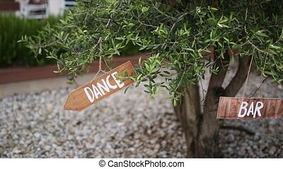 "The tablet ""Dance"" on an olive tree. Wedding decorations. -..."