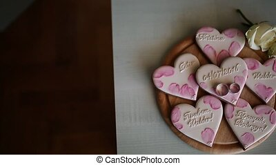 Cookies in the form of hearts. Wedding inscriptions. Pink...