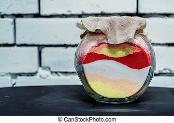 Colored sand poured in layers in a bottle - Souvenir glass...
