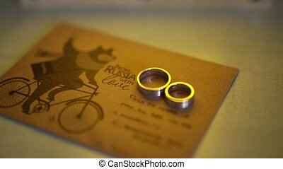 Mail envelope with a bear on a bicycle. Wedding rings...