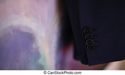 Close-up of buttons on a man's jacket. The wedding dress of...