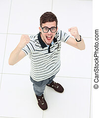 Everyday winner. Top view of happy young man expressing...