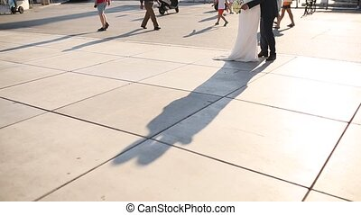 The shadow of the couple on the floor. Silhouette of the...