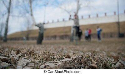 Acrobatics teenagers - a tracer jumps a flip at park,...