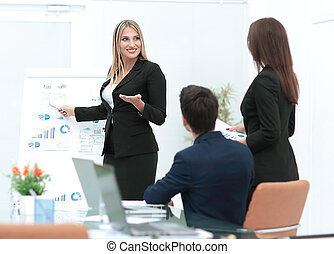 Business woman making a presentation at the office