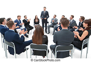 Business group greets leader with clapping and smiling -...