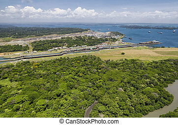 Panoramic aerial view of Gatun Locks with cargo ships...