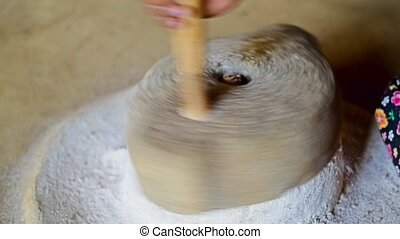 Using grinding stone - Grinding flour with old primitive...