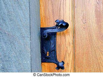 Historic door handle. Wrought black door handle.