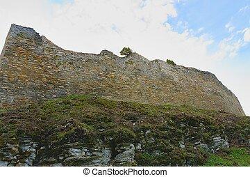 Ruins of fortification (bulwark). Medieval rampart.