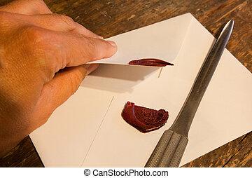 Breaking a wax seal