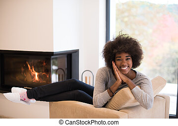 black woman in front of fireplace - Young beautiful african...