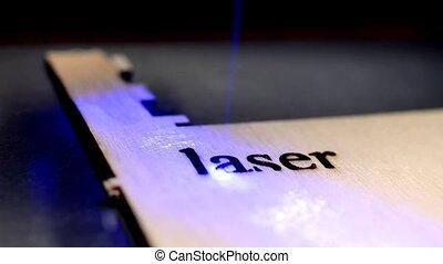 Laser machine operation during engraving.