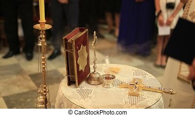 Cross and bible on the table in the Orthodox Church