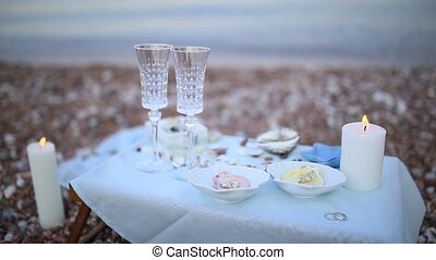 Dinner by the candlelight on the beach. A table for a romantic d