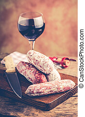 salami and red wine - italian food concept