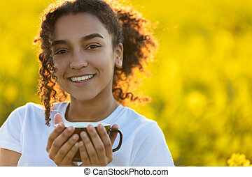 Mixed Race African American Teenager Woman Drinking Coffee Outdoors