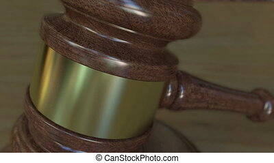 Judge's gavel and block with JUSTICE inscription. 4K clip -...