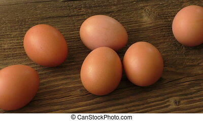 Brown eggs on wooden background