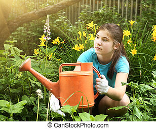 teenager girl with orange water can close up photo in the...