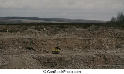 Truck loading in a quarry - Time lapse of a truck loading in...