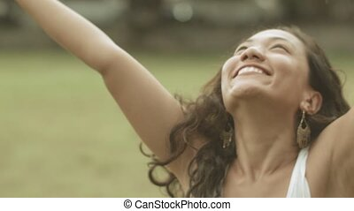 Close up portrait of happy girl raises her arms up