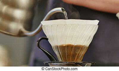 Pouring water on coffee ground with filter. Close up. Slow...