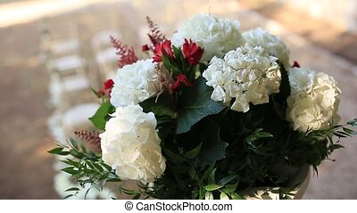 Hydrangea flowers in a pot. Wedding decorations in...