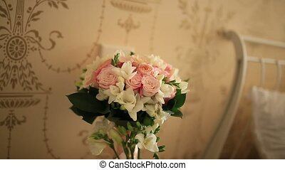 Wedding bouquet of pink roses on the table, laid out a...