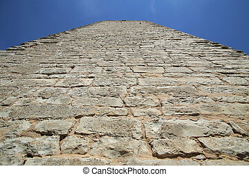 Unusual wide angle upward view of a castle keep.