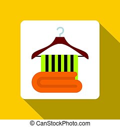 Green towel on on a wooden coat hanger icon
