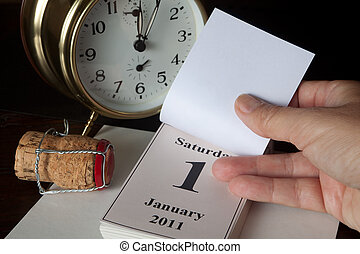 New year's calendar page - Alarm clock and calendar showing...