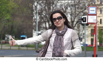 Young female tourist hailing taxi cab in Europe, HD 1080