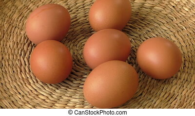 Fresh brown egg in a basket, chicken egg