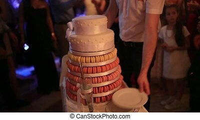 Wedding cake with red biscuits. Wedding at the sea in...