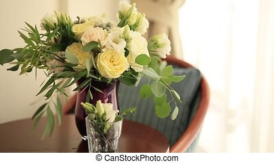 Bridal bouquet of roses and eucalyptus on a table. Wedding...