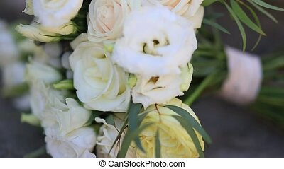 Bridal bouquet of roses and eucalyptus on the rocks. Wedding...