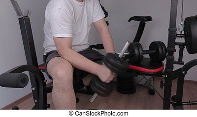 Man doing hammer exercise with dumbbell