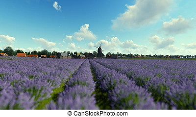 French lavander village with old windmill against blue sky, panning