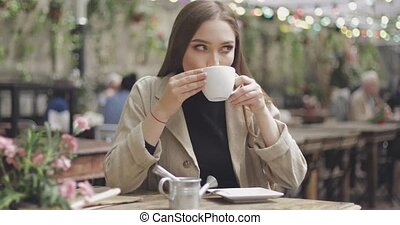 Lovely female enjoying coffee - Gentle and stylish woman...