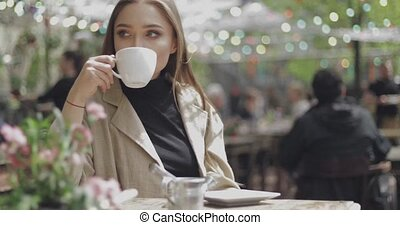 Girl holding cup up - Smiling beautiful female holding cup...