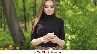 Trendy female outside with smartphone - Beautiful and...