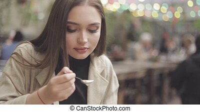 Female licking spoon - Beautiful female in casual clothing...