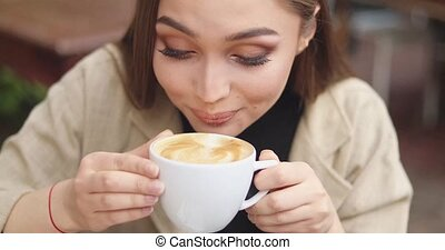 Woman drinking freshly made coffee - Young female in stylish...