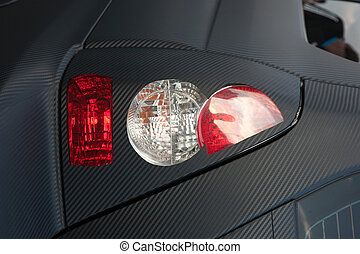 Stoplight  - Closeup of Stoplight of modern black car