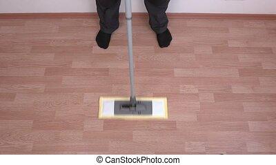 Cleaner using mop on floor
