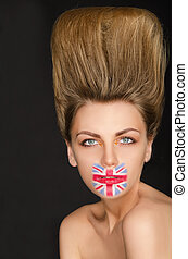 Portrait of woman with english flag on her face
