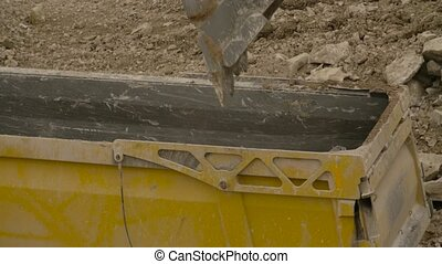 Loading of the truck in a quarry - Close up of loading of...