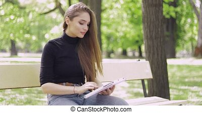 Beautiful young girl with tablet - Young girl with long hair...