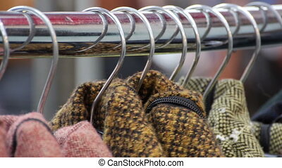 Close-up of a clothes rail with coats - Close-up of a...